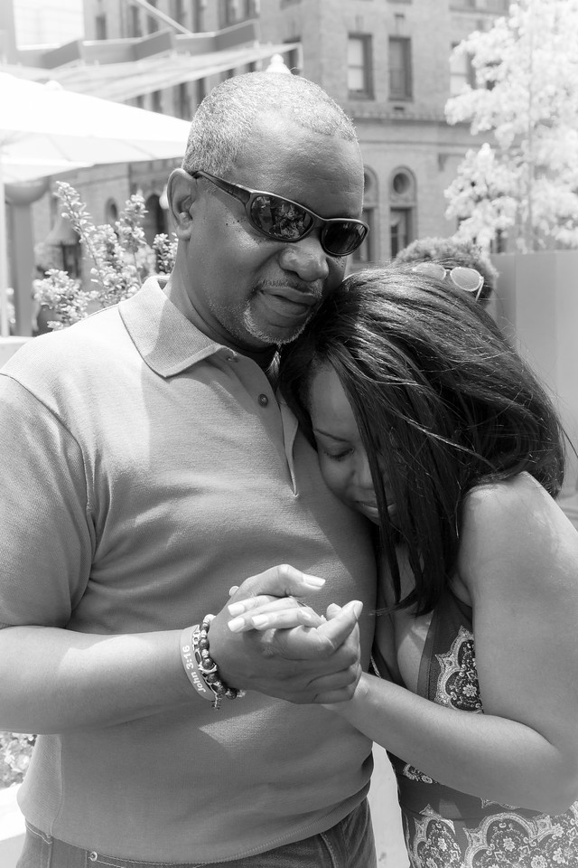 De'Shera hugs her father after Nic's classic proposal in downtown Norfolk, VA.