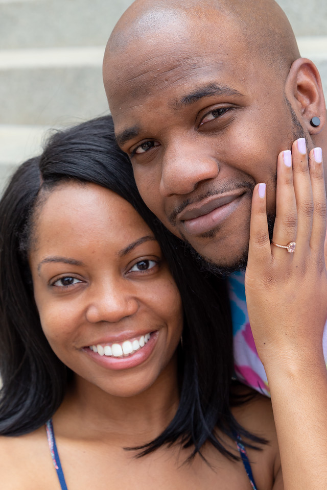 De'Shera flashes her new, timeless engagement ring with Nic after their classic proposal in downtown Norfolk, VA.