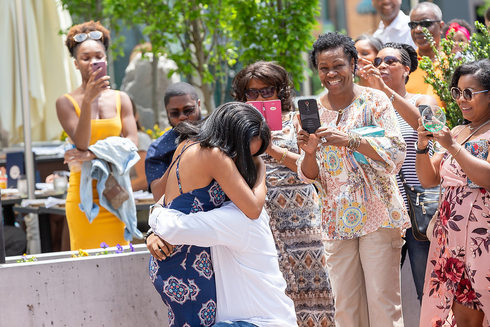De'Shera and Nic embrace each other after the classic proposal in downtown Norfolk, VA.