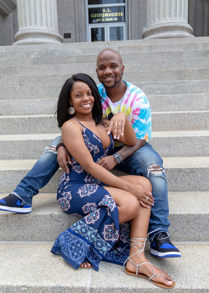 Nic and De'Shera pose for a photo after their classic proposal in downtown Norfolk, Va.