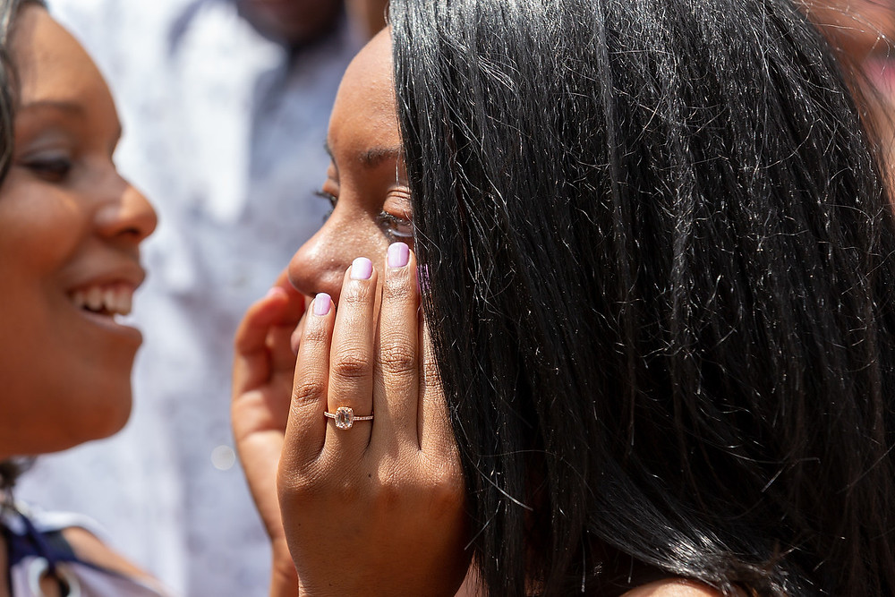 De'Shera sheds tears of joy after the classic proposal in downtown Norfolk, VA.