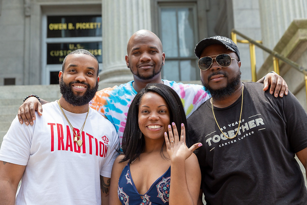 De'Shera and Nic share moments with family and friends after their classic proposal in downtown Norfolk, Virginia.