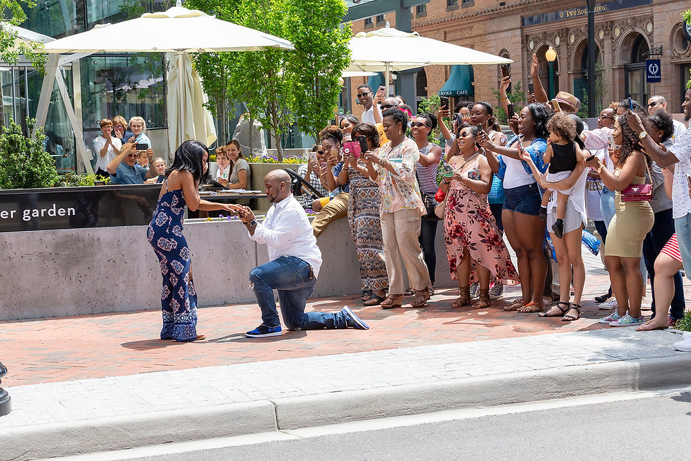 De'Shera puts on her engagement ring after Nic's classic proposal in downtown Norfolk, Virginia.