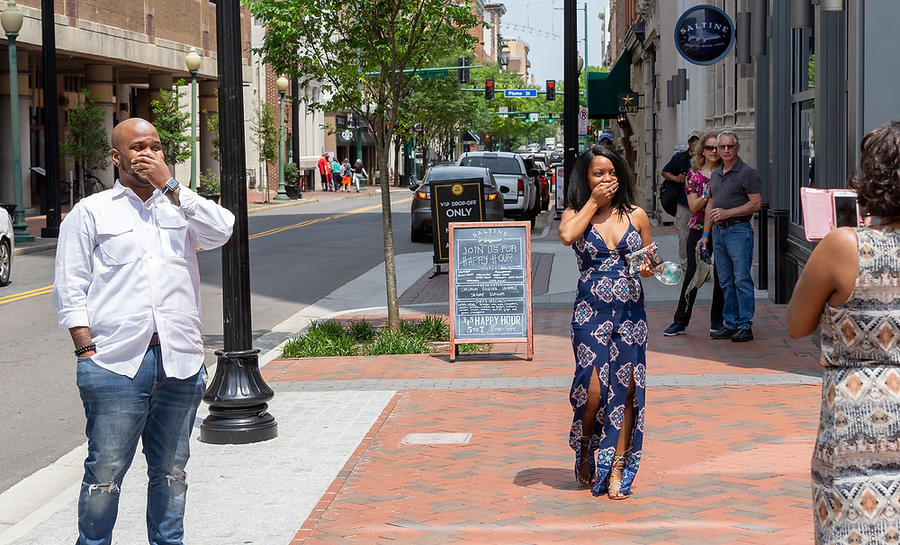 Nic and De'Shera walking up to the proposal location in Downtown Norfolk, VA.