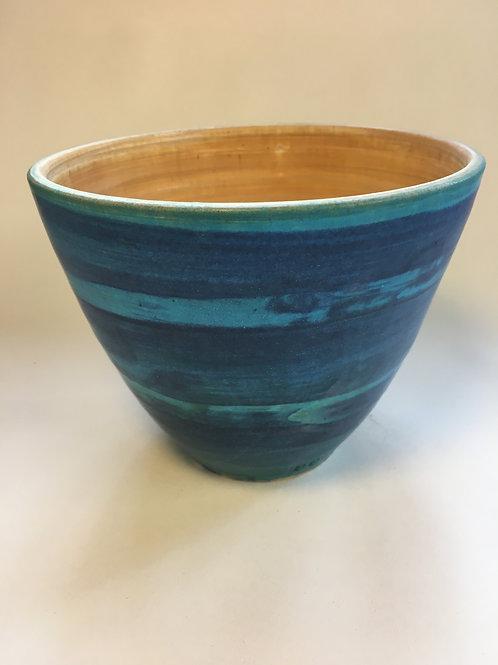 Deep blue bowl with tan interior