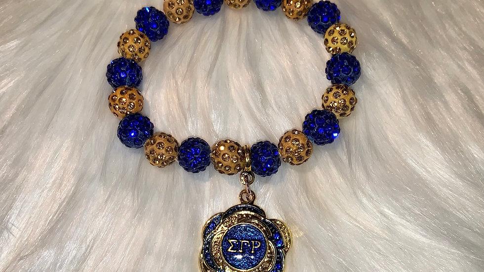 Sgrho gold and blue bling bracelet