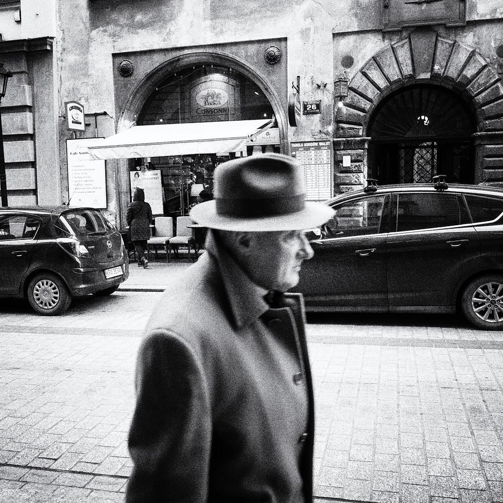 Man in a hat street photogrpah from Krakow, Poland