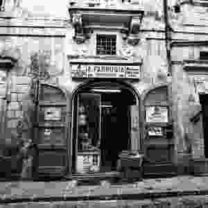 Old buildings and shops in malta. This photograph shows a Ironmongers aith an old Hammerte sign on the door