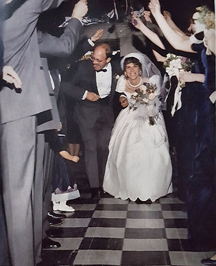 Maureen am=nd Mikes wedding 1990. IStill love the gown and tuxedo!