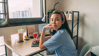 Tammy sitting at work desk using an iPad