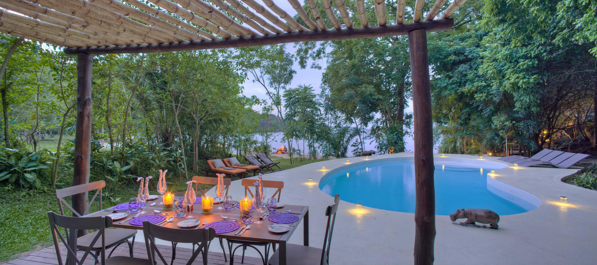 Private Dining by Pool Rubondo Chimp Isl