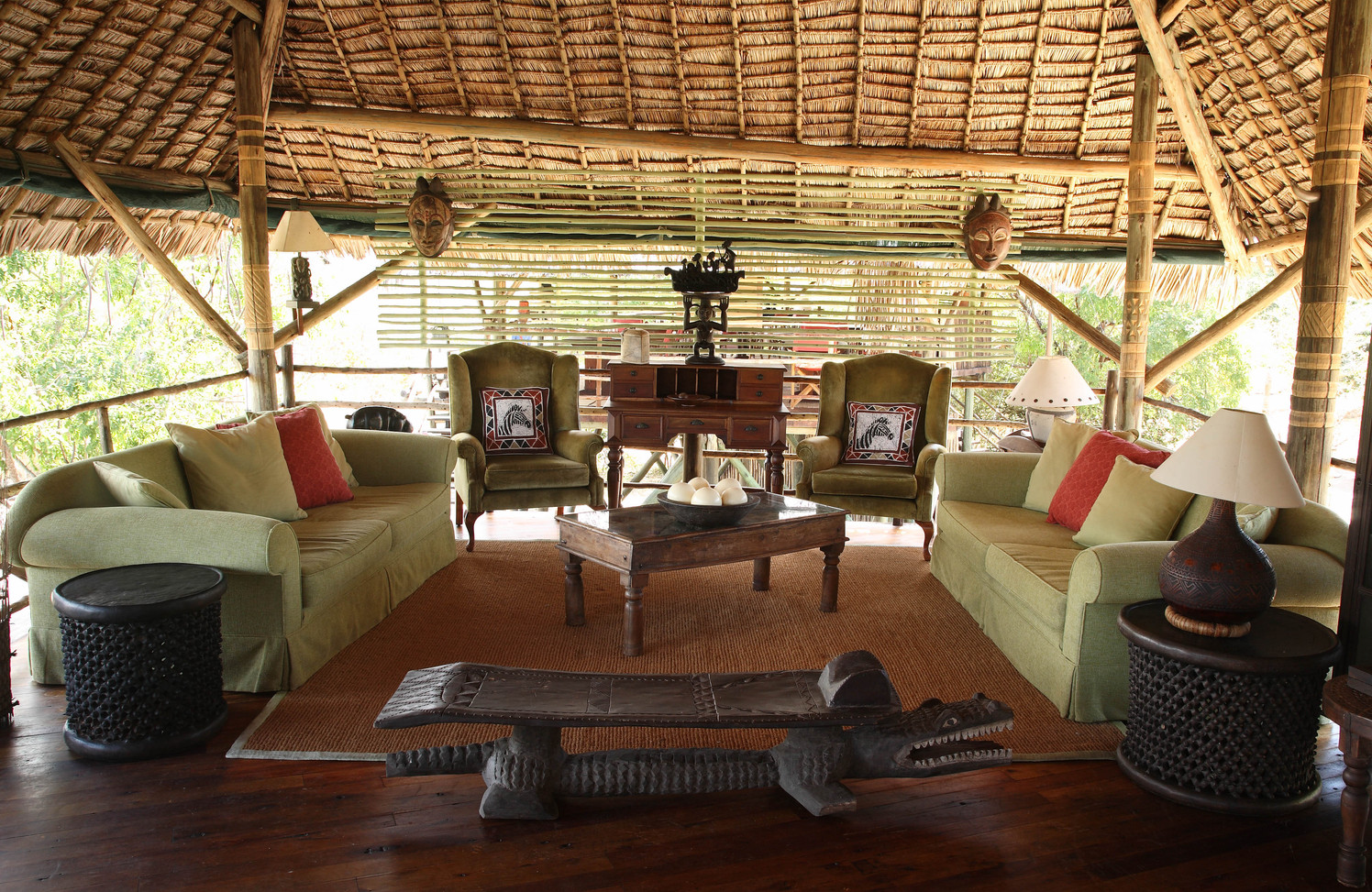 Homely lounge with reference books at Siwandu, Nyerere, Selous