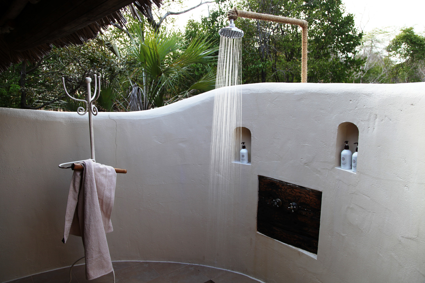 Outdoor showering at Siwandu, Nyerere, Selous