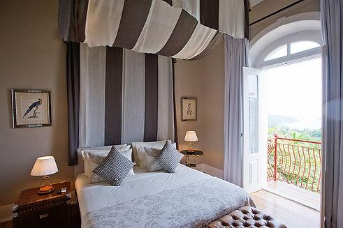 Belo Luxury Suite Bedroom.jpg