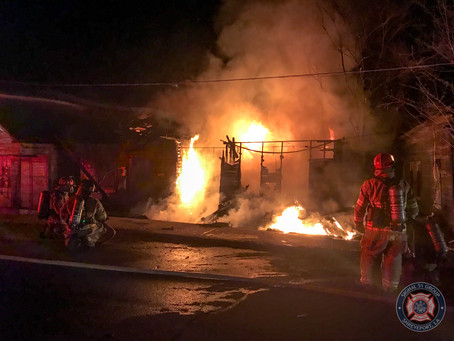 Fire Destroys Three Houses on Travis Street