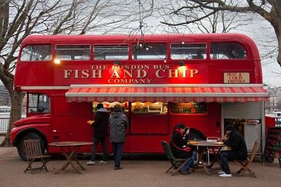A traditional red double-decker London bus converted into a mobile Fish & Chip shop