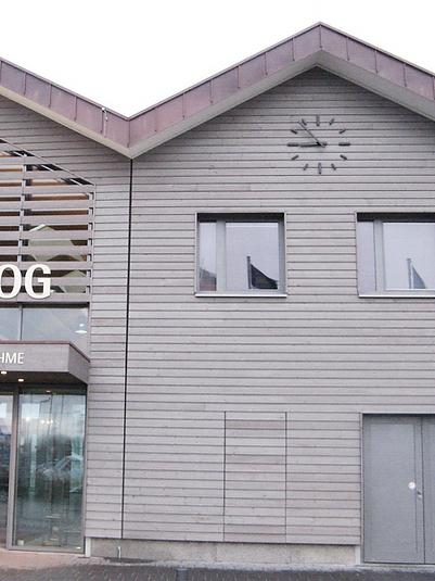 Modern tower clock at the ferry port on Langeoog