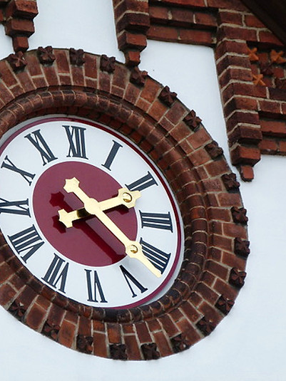 Facade of a private house with coloured outdoor clock