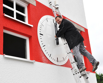 Installation of the public clock at the tower of the soccer stadium of the SSV Jahn