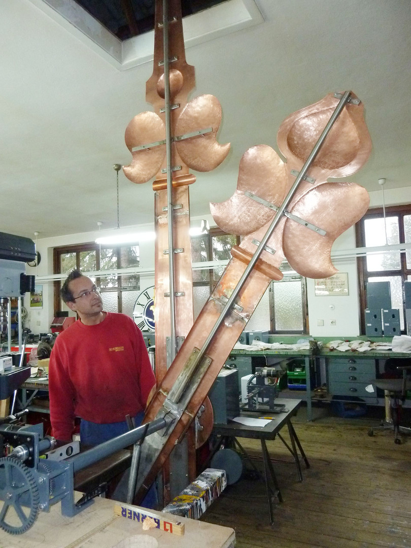 Manufacturing of baroque hands for the 5 m dial of the tower clock for the lighthouse in Bengasi, Libya