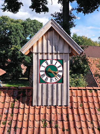 Private property with clock tower made out of wood