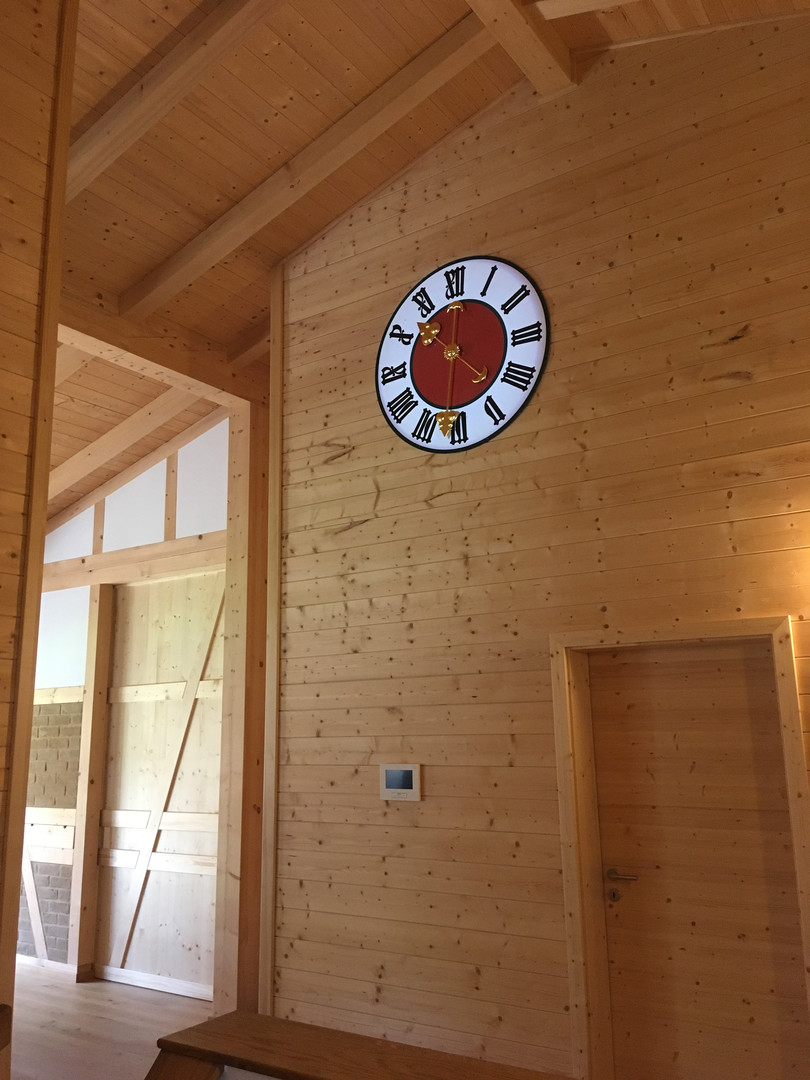 Tower clock for a house in wooden construction