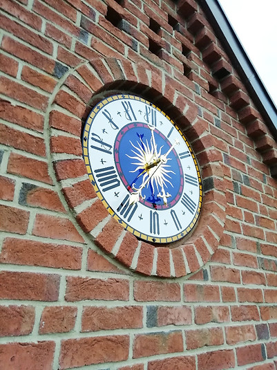 Decorative tower clock for private house with brick facade