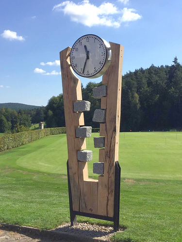 Double sided public clock for golf course with battery operated radio controlled clockwork