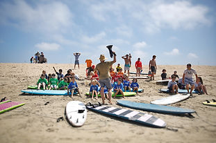 Group surfing lesson in Huntingon Beach