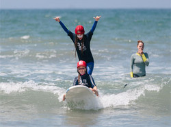 Two girl surfing together