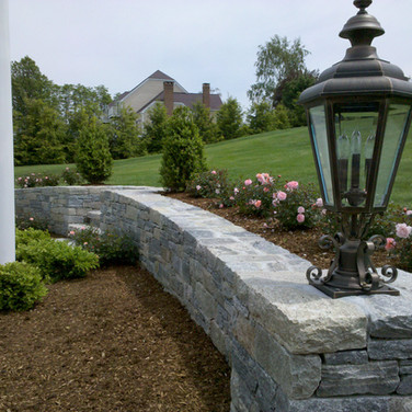Stone retaining wall with steps in Wallingford, CT