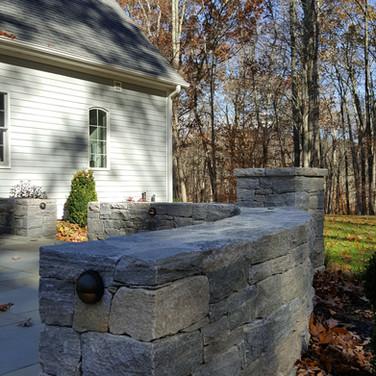 Granite sitting wall and stone pillar