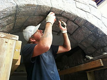 Stony Creek Granite stone veneer beign istalled on home in Branford, CT.  This is a custom stone arch we built