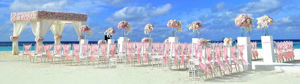 Extravagant floral beach wedding ceremony