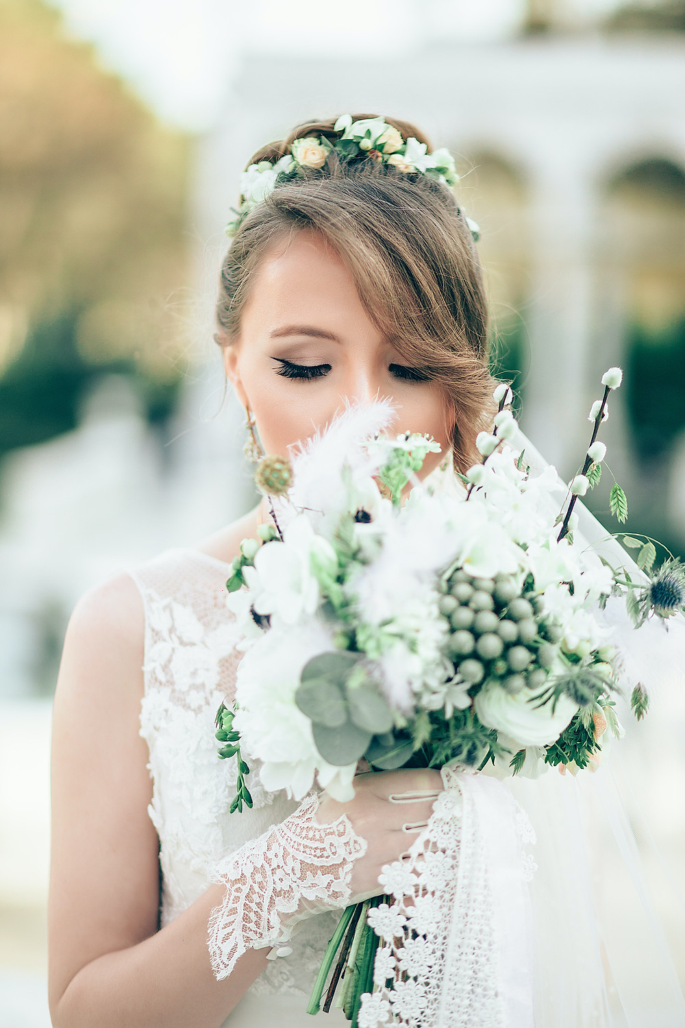 nervous bride walking down aisle with green and white bouquet