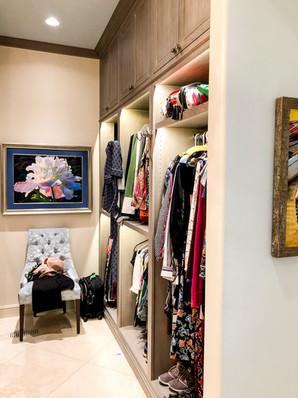 Jewelry Case behind art, custom closet