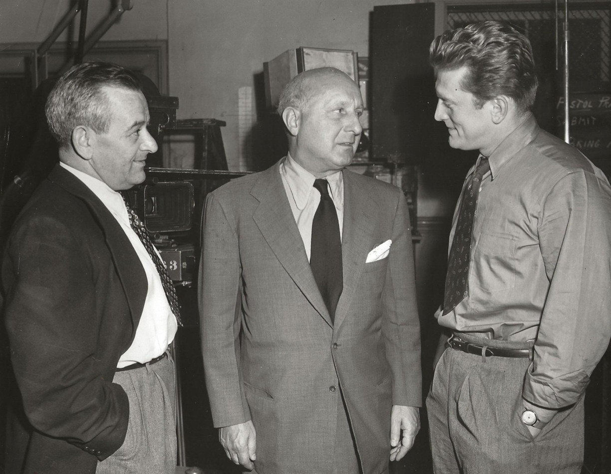 Barney Balaban, President of Paramount Pictures (Centre), Kirk Douglas, movie actor (Right) and William Wyler, Director (Left)