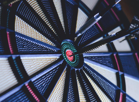 Significant improvement in darts performance following lucid dream practice, less when distracted