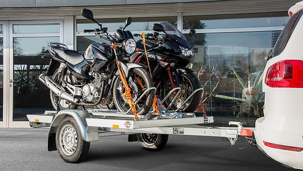 transport motocicleta pe platforma.jpeg