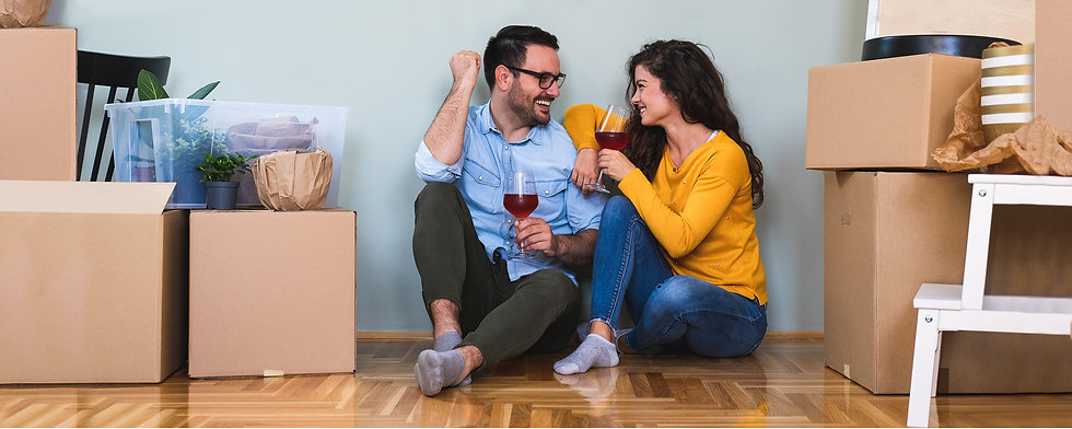 A young couple who just moved in a new home showing they just purchased real estate