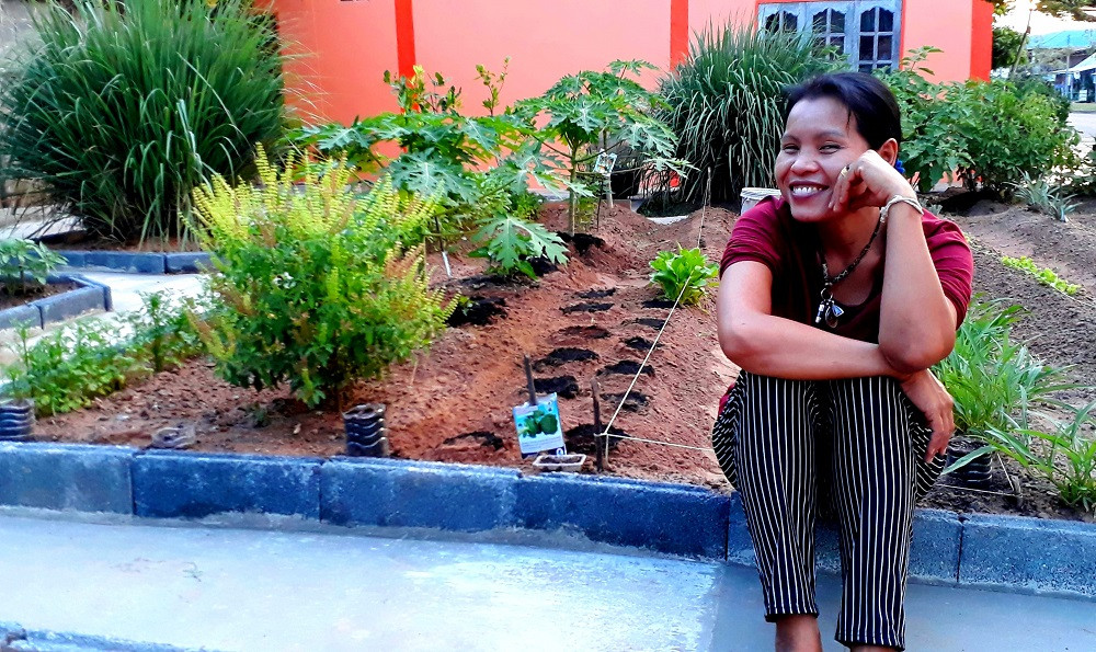 """My wife """"Natthan"""" (Rose) supervising me while I am planting new garden seeds"""