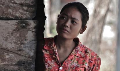 Cambodia lady watching clinic