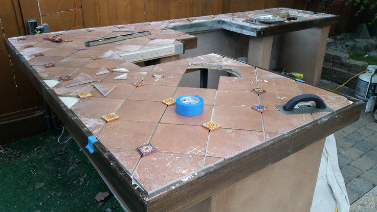 Setting Tiles to Build Counter Top