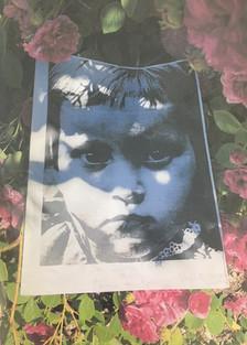 Sad girl in flowers.JPG