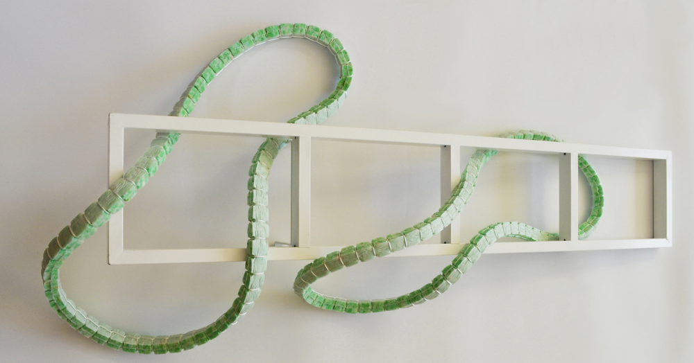 "Sam Haynes sculpture, ""Loop the Loop"". Foam underlay, kite cord, CD wall rack."