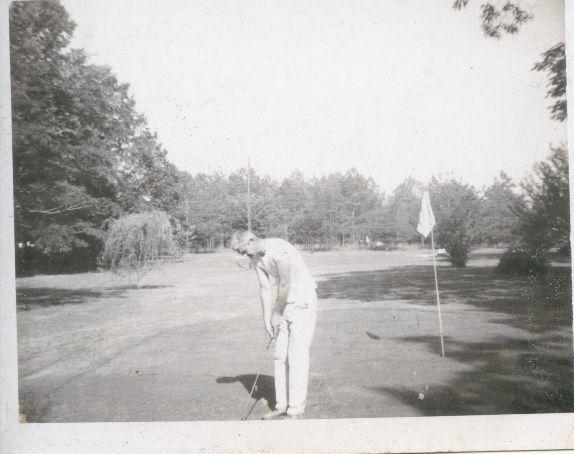 Dad on his putting green