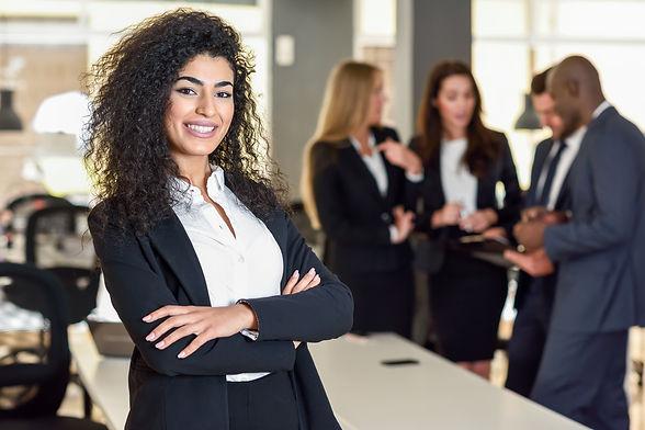 businesswoman-leader-in-modern-office-with-businesspeople-workin.jpg