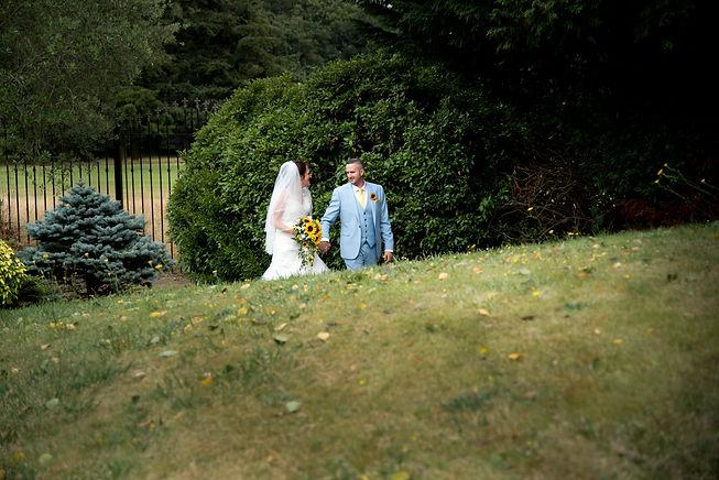 Bride an Groom taking a stroll in the hotel gardens