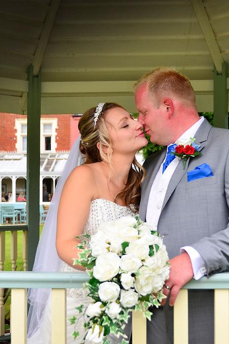 Bride and Groom under the pergola