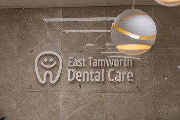East tamworth dental care reception logo